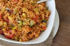 Jambalaya with Summer Squash  [you can totally add either chopped chicken or lean beef to this recipe]