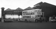 Archive black  white photograph of a double decker bus outside Hove Railway Station