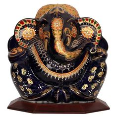 Buy 24 carat gold plated promotional gift items such as religious wall hangings,  spiritual table tops, Religious Glass Frames etc with Lord Ganesh Image.
