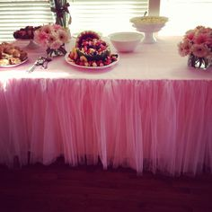 Pink tutu food table for baby girl shower made with pink tulle