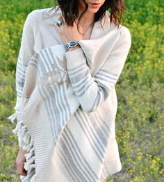 I've got to warn you — once you wrap up in this cozy long cardigan, you might find yourself thinking about curling up beside the fire with a good book, or drinking tea, or, in rare instances, building a snowman.