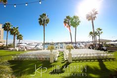 Seaside ceremony site with white florals   Balboa Bay Club Resort Wedding   Newport Beach, CA   Coordination by Jeannie Savage Details Details   White Lilac Flowers and Linens   Flawless Faces Makeup   Lindsey Neavit Hair   Plug Video   Jay Sterling Music   Jim Kennedy Photographers