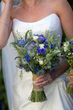 Hessian wrapped bouquet with a blue rustic theme. Conflowers, Scabosia, Delphinium, Panicum, Thlaspi and Wheat. lullahbelle.co.uk