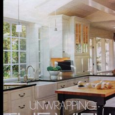 Airy, open kitchen layout... Pic from an old BHG mag April 2004