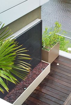 #Slate #water #wall in a #contemporary roof terrace in Islington