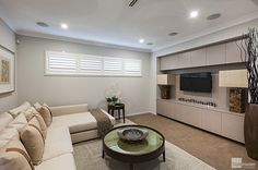 Media room in the Milan by Stylemaster Homes