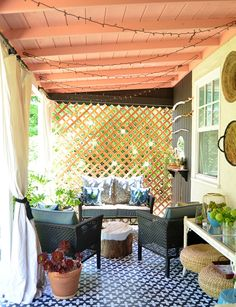 We love how the stenciled pattern on the cement patio coordinates with the trellis privacy wall in this back porch. See the rest of this patio makeover by Shavonda Gardner of SG Style on The Home Depot Blog. || @SG_Style