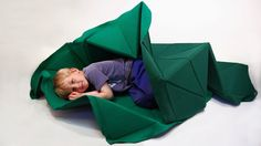 "Studio Gorm's ""Construction Quilt"" is made from a mesh of foam triangles that let kids morph it into anything they can dream up."