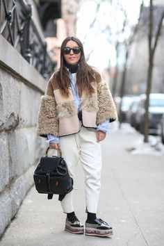 Below-Freezing NYC Street Style That's Still Fire #refinery29  http://www.refinery29.com/2015/02/82279/new-york-fashion-week-2015-street-style-pictures#slide-16  A case where a little bit of everything makes a big, bold statement. Gucci backpack.