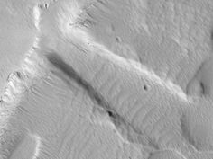 A piece of Mars: This is a bit of the flank of Arsia Mons, one of Mars' great volcanoes. The topography was made by erosion from lava and great tectonic pulling. What I like is that the scene (1.58x1.18 km, or 0.98x0.74 mi) is covered in bright dust (looks a bit like snow here, doesn't it?). And that dust has been eroded by wind channeled through the topography. So here we see signs of flow, both from ancient lava and from more recent wind. (HiRISE ESP_031944_1790, NASA/JPL/Univ. of Arizona)
