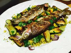 Trout with courgette and cauliflower couscous, on a white plate