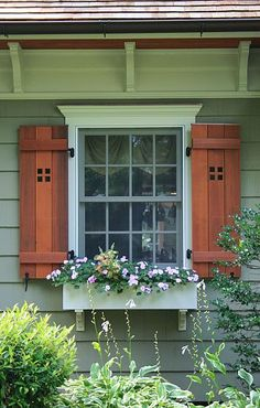 Cape Cod Renovated into Craftsman Style Home. LOVE the trim, functional shutters, and window box combination.