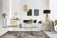 Anyone else wishing they could relax in this luxurious space?! This rug incorporates all the colors in the room, making it the perfect addition. Home Decor Uk, Winter Home Decor, Home Decor Styles, Cheap Home Decor, Lampe Industrial, Clean Couch, Sala Grande, White Brick Walls, Tapis Design
