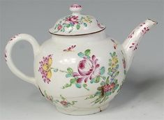 An 18th century Bow porcelain teapot and cover, of bullet shape, polychrome decorated with sprays