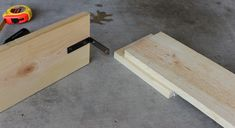 After measuring the same length from the end of both boards, and using the brackets as a guide to mark my holes, I drilled pilot holes and then screwed in the screws. Industrial Dog Beds, Rustic Industrial, Bed Styling, Bamboo Cutting Board, Pillows, Wood, Diy, Mattress, Boards