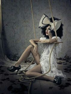 I like this image because of the 'broken toy' feel to this image with the swing and the doll set up.