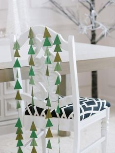 Event designer Camille Styles adds a handmade touch to holiday gatherings with one-of-a-kind chair swags made from simple crafting materials, as seen on HGTV.com.