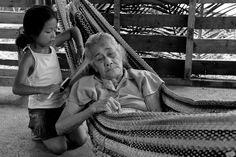 Child brushing grandmother's hair. Costa Rica.
