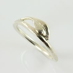 Small silver ring with leaf. A slender branch with a small leaf has been breathed on by elfin girl. It turned into silver and was shaped by my hands into a ring. Had there been a dewdrop on the leaf, perhaps it had turned into a diamond? A somewhat larger leaf and twig was turned into a silver bracelet
