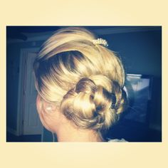 Braided low side bun with a little tease :)