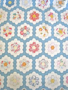 Love the blue on this quilt.  Would be lovely with a pale pink for the second round of the hexie flowers...