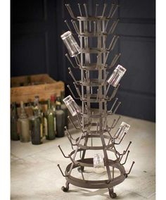 Fabulous for bar or pub décor, or in a large kitchen, this drinking glass rack is striking to behold. It features a multitude of prongs for drying glasses, and a vintage, industrial steam-punk look. $315.00