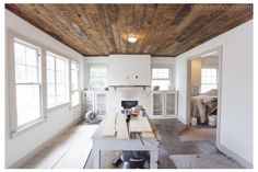 Gray trim. White walls. Reclaimed wood.