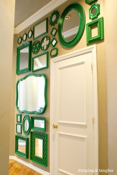Mirror gallery wall- collect thrift store mirrors and paint them all the same color! I love this & you could do it in any color you choose!!