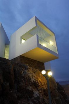 A beautiful beach house in Lima, Perú - with gravity-defying geometry, and many charming terraces for perfect seaside breakfasts!