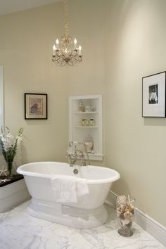 I think this is a great idea but the chandelier needs to be a touch bigger because the large tub decreases its grander.