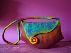 A colorful spiral embellished purse by Australian fibre and textile artist Pam de Groot