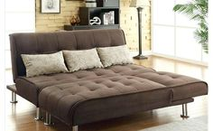 Brown Couch, With Three White Cushions On The Sofa, And Neat