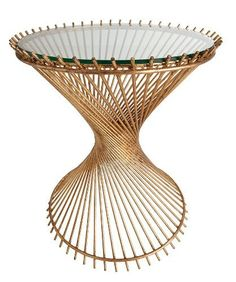 "Arteriors Pascal Iron/Glass Side Table by Arteriors. $1130.00. H:26"" Diameter:21.5"". Gold-leaf rods angle around a double ring, each reaching for the opposite side of the implied cylindrical form that contains them, in the artful construction of the round Pascal Side Table. This glass-topped end table has an hourglass shape familiar from nineteenth-century empire bamboo and wicker furnishings, updated in luxurious metal. Use it to transition between traditional vintage p..."