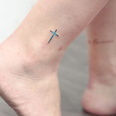 Subtle tattoo by Anzo Choi. subtle microtattoo pastel southkorean feminine girly tiny cross