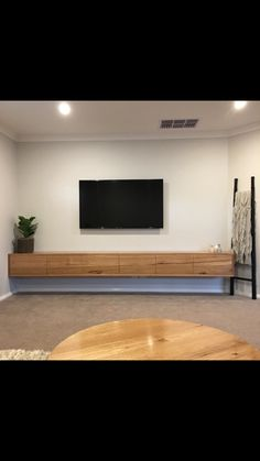 Floating TV unit made from solid Messmate timber with push to open drawers & cupboards