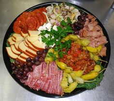 Italian cured meats, crostini, olives, our famous caponata, cheeses,and marinated vegetables make up Blue Mountain Bistro-To-Go's #antipasti #catering #luncheon #coldcuts #HudsonValley #Catskills
