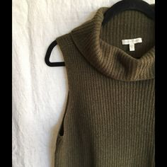 Eileen Fisher Sleeveless Tunic Sweater (L) Gorgeous olive color 50 Yak/50 Wool sleeveless sweater with cowl neck. Side slits, tunic length. Second pic is to show how it looks on. Worn once, EUC. No trades. Eileen Fisher Sweaters Cowl & Turtlenecks