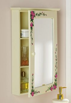 """Pink Rose Floral Bathroom Medicine Wall Cabinet Item #: 25226 / $ $19.97 from Collections Etc. catalog.  Beautiful wall cabinet in eggshell white includes mirror & hand-painted pink roses. Opens for extra storage. Wood/glass. 11 1/2""""L x 3 1/4""""W x 17 1/2""""H."""