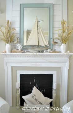 beach painting with light florals and candles makes the perfect rh pinterest com Decorating Fireplace Mantels for Christmas Fireplace Mantel Decorating Ideas