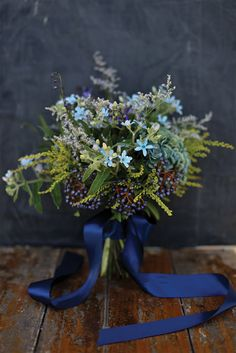 A bouquet in varying shades of blue tied with indigo ribbon. Photo Source: leaf and honey #bouquet #indigoblue