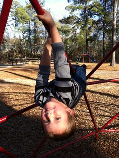Wyatt playing on the jungle gym thing...