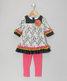 This tunic blends playfully patterned prints and lace overlay with soft knit fabric. It slips on simply thanks to buttons in back for perfect pairing with the matching leggings.
