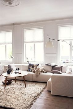 Homes: Danish: Different tones of white in the living room. Wondering whether we actually need curtains for our living room.