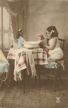 little girl playing with her dolls