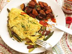 Japan's omurice, which also goes by the names omumeshi and omuraisu, is an addictive dish of fried rice served with an omelette. It's surprisingly easy to make at home. In this recipe, the rice is fried with onion, carrot, and diced chicken, then tossed with ketchup to form a flavorful glaze.