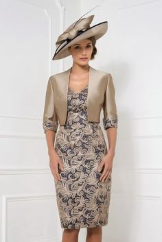 25787 (John Charles) A beautiful design by John Charles. This wedding outfit oozes sophistication and elegance. The dress has a heavy lace overlay in Nutmeg with a Navy lining underneath. The dress has capped sleeves and a V at the Read More...