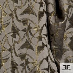 This beautiful chocolate colored brocade has a medium weight and drape. The taupe brown is slightly crinkled and contrasts very well with the metallic bronze and gold graphic design. - See more at: https://fabrics-fabrics.com/index.php?id_product=510&controller=product#sthash.rz6VXF2Z.dpuf