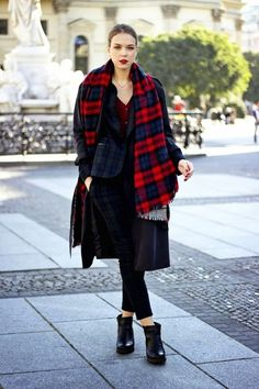 Unwrapped plaid scarf worn with plaid pantsuit and ankle boots