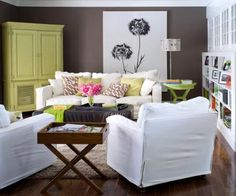 Bold style  Rich brown walls, a lime-green-painted TV/armoire and an oversize piece of art make this room memorable. Slipcovers on seating can be easily removed for cleaning