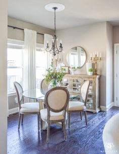Decked and Styled Spring Home Tour - Kelley Nan- dark hardwood floors in breakfast nook with brass round mirror